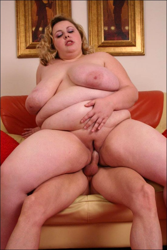 Naughty bbw Holli seduces a guy with her big belly and then takes cock in her mouth to size it up and then she is humping on top